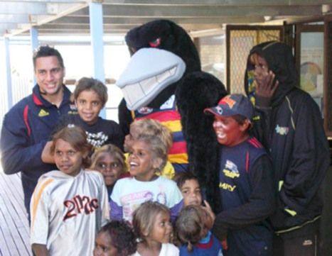 Andrew McLeod, Claude the Crow and they APY kids (Photo courtesy AFC)