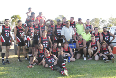 A weary Coober Pedy Saints team after playing four games. Photo: Jessica Norris