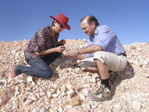 Dr Patrice Rey and colleague Adriana Dutkiewicz inspecting samples on a recent visit to Coober Pedy