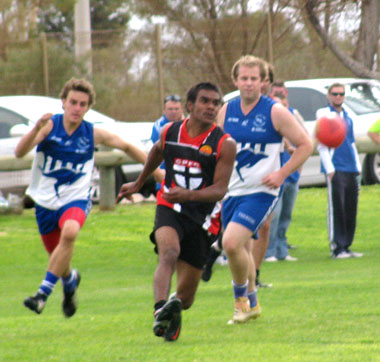 Fabian Kenny leads the pack in persuit of the ball