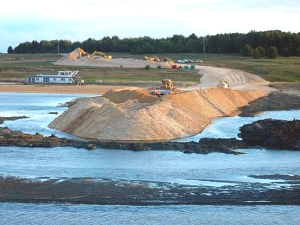 July 21, 2009. Clayton Bay. The displaced mud deepens, the banks of the dam slump, the road sinks. The silt flows back into Lake Alexandrina. Stop construction now!
