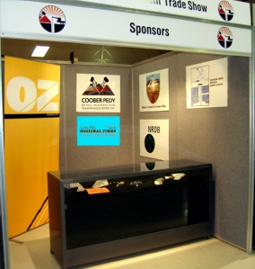 Many alternative man hours contributed to the success of the Gem Trade Show. Above is the booth displaying other sponsors