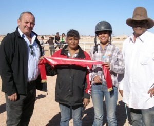 "Robert Coro presents second place ribbons to ""Taken Charge"", L-R Colleen Taylor, Jockey Gemma Hunt and Ronald Boland"