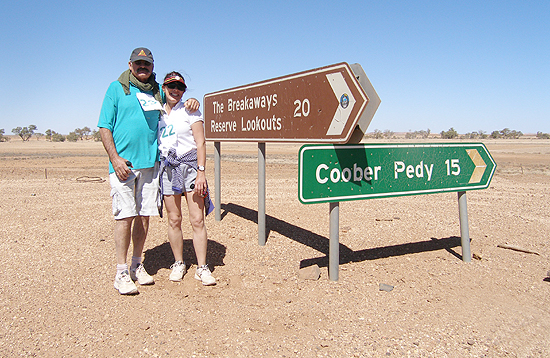 Dave Bowman and Julie Carmichael at the Oodnadatta Rd turnoff from the Dingo Fence on their 17.5Km Walk