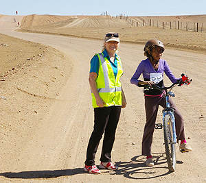 On the road along the Dog Fence are Joy Griffiths and Patricia Brown cyclist