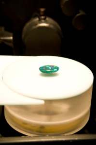 A suction pump holds an opal in place on the stage inside the Gemmological Digital Analyser (GDA)
