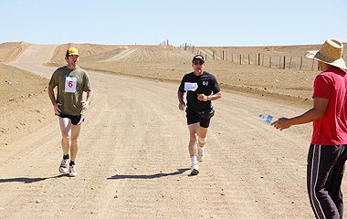 35km Runners William Banks and 'Mayor on a mission', Steve Baines get ready for refreshments on the run