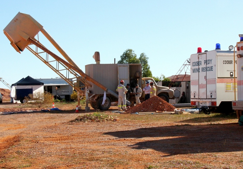 Coober Pedy Mine Rescue Squad implement an opal mining blower to assist police with extracting soil from a mine shaft in the search for missing teenager Karen Williams