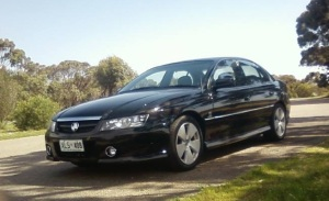 Black 2004 VZ Holden Commodore sedan with the SA registration number XLS408 missing from the property.