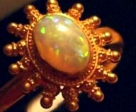 One of the opal and solid gold rings stolen by thieves